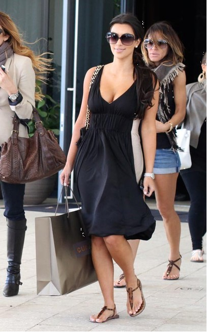 c5ba50eff81f Kim Kardashian matches her Sam Edelman Gigi flat sandal with a simple black  sundress while spending an afternoon shopping in LA. Here Ashley Tisdale ...